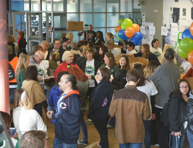 crowd of people at a community engagement exhibition