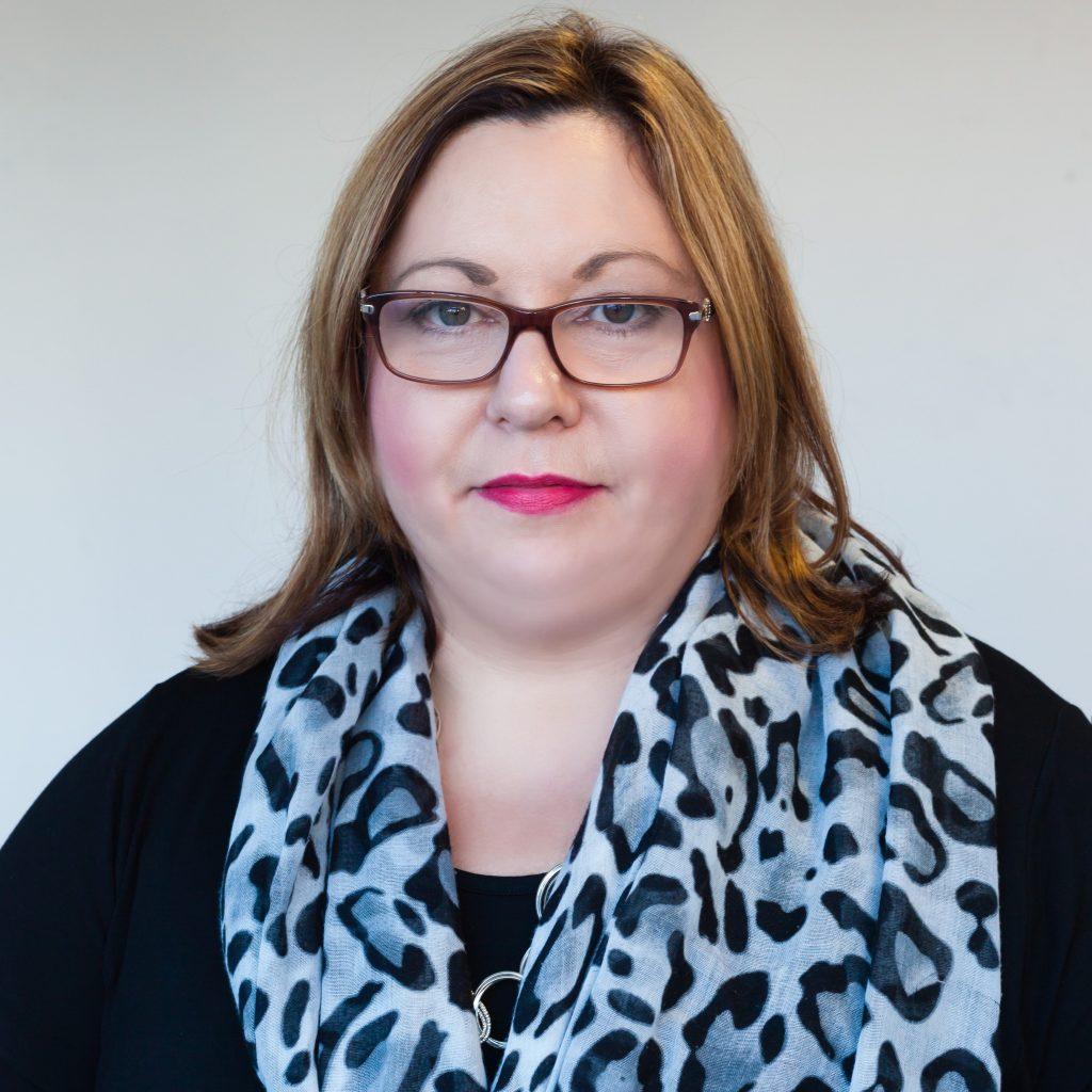 Professional headshot of Caroline Masundire