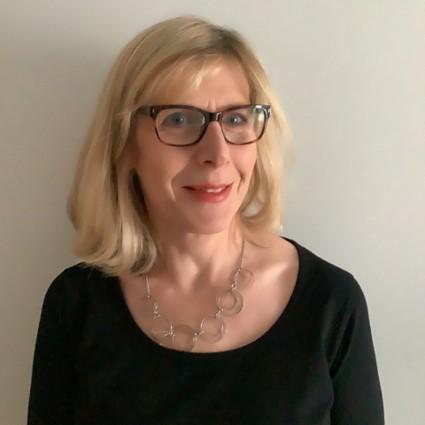 Professional headshot of Irene Kinroy