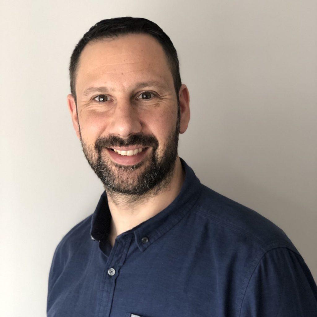 Professional headshot of Michael Theodorou