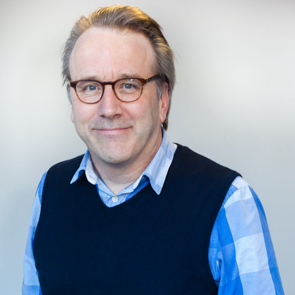 Professional headshot of John Griffiths