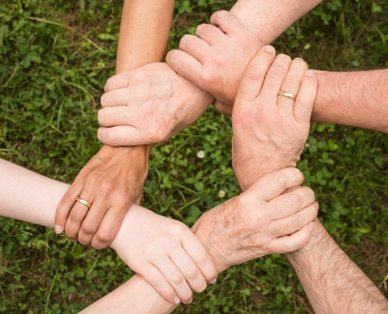 six linked hands